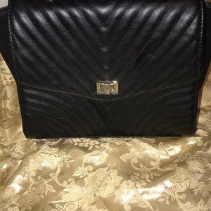 Gently used black leather handbag